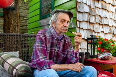 Lowell Davis sitting in Red Oak II, Missouri, enjoying a smoke