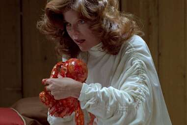 Samantha Eggar in the brood, baby in the brood