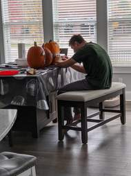 guy carves pumpkins to look like dog
