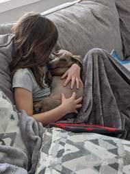 girl holds cute dog