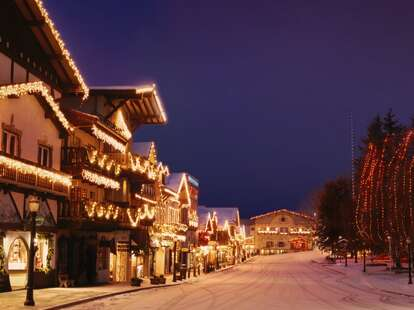 A quaint town decorated in holiday lights.