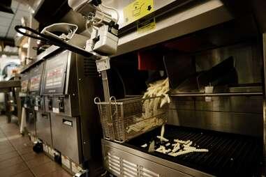 Flippy dispensing fries for frying