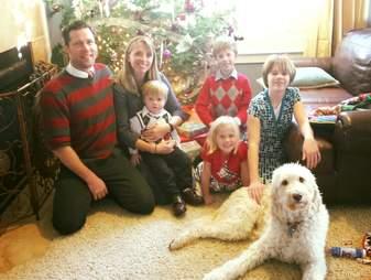 dog and family at Christmas