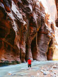 man in river canyon