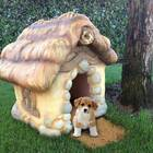 A storybook-style dog house that looks like it was carved from your dreams