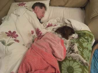 Dad sleeps downstairs with dog to make sure he's comfortable