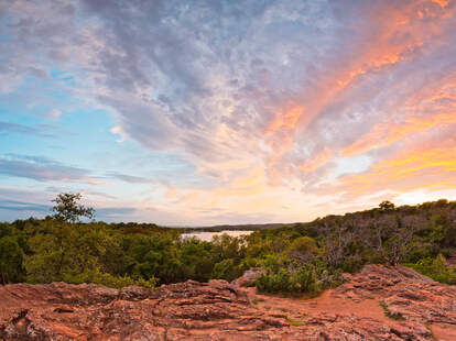 Granite Hills Of Inks Lake State Park Against Fiery Sunset