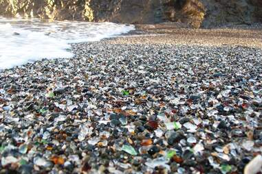 Close-up view of the colored glass beads mixed in the sand at Glass Beach near Fort Bragg, CA