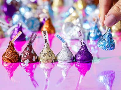 Several varieties of Hershey's Kisses in various colors of foil wrappers.