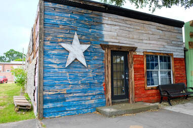 Old rustic building on Main Street in Tomball, Texas
