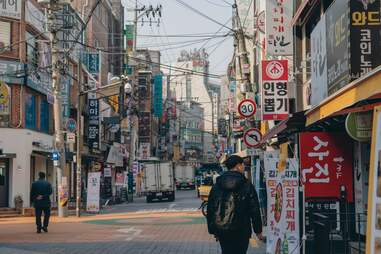street with billboards and pedestrians in seoul, south korea