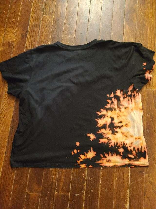 Dog creates an awesome design on a shirt with bleach
