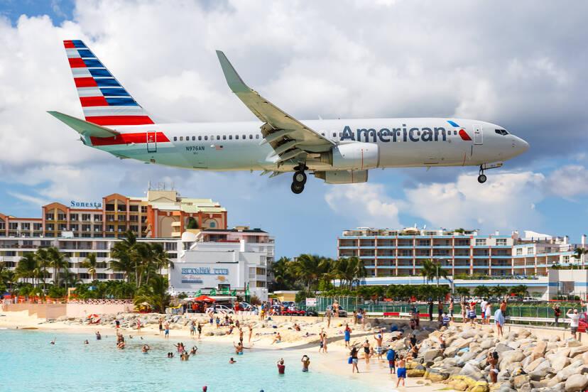 American Airlines plane flying low over Sint Maarten in the Dutch Antilles