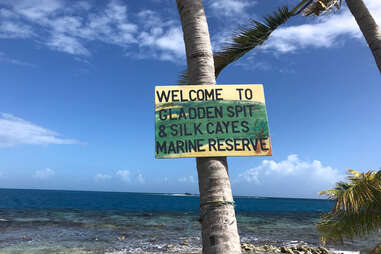 a sign for Gladden Spit and Silk Cayes Marine Reserve in Belize