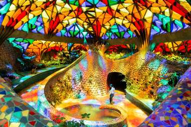 a woman in a kaleidoscopic room