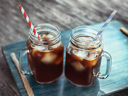 Iced cold brew in Mason jar glasses with handles