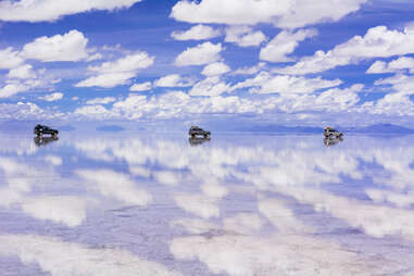 cars driving across the Uyuni Salt Flat