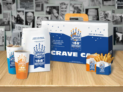 "A White Castle ""Crave Case,"" sodas, fries, and a slider."