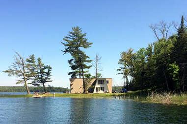 a-frame house on a lake