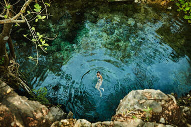woman swimming in cenote