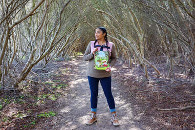 Ambreen Tariq, founder of Brown People Camping, standing in the woods