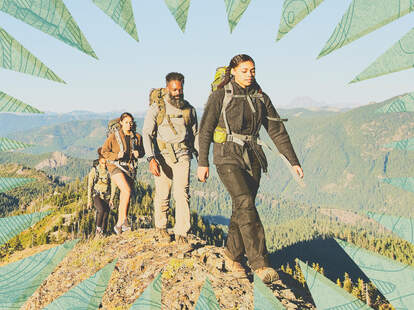 four people hiking over a mountain
