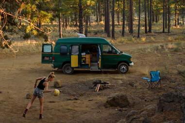 Van camping in the woods