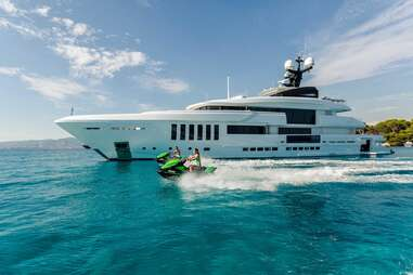 private yacht and people on jet skis