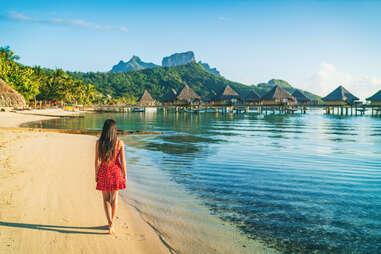 woman walking on the beach in Bora Bora, French Polynesia