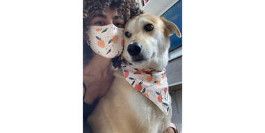 woman and dog in their matching Goodboy mask and bandana set