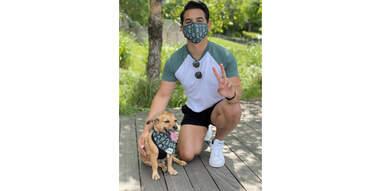 man and dog wearing matching Goodboy Mask and Bandana set