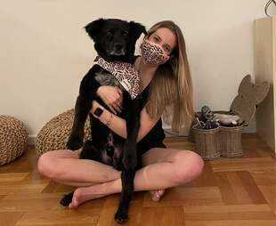 woman holding dog wearing matching Goodboy mask and bandana set