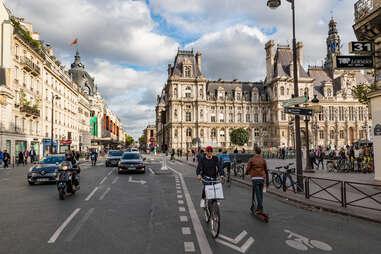 people riding bikes down Rue de Rivoli, Paris