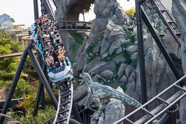 guests riding the Jurassic World Velocicoaster at Universal Studios Florida