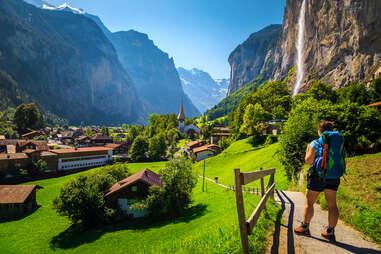 woman hiking in Lauterbrunnen village, switzerland