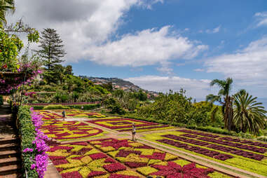 people walking through a colorful garden at Monte Palace Tropical Garden on Madeira Island