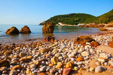 rocky beach at Portinho da Arrabida in the Parque Natural da Arrabida, Setubal, Portugal