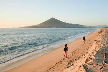 Moledo beach at sunset with Insua Fort in the background