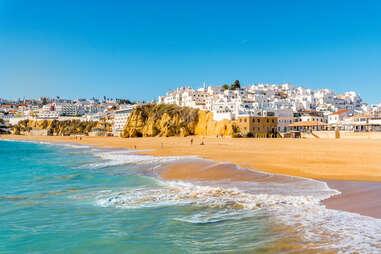 Wide sandy beach in white city of Albufeira, Algarve, Portugal