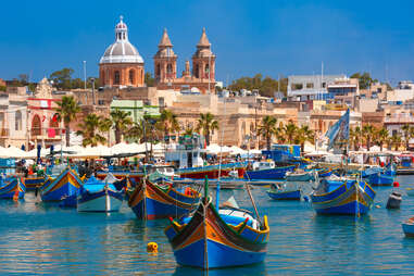 boats in the bay in Marsaxlokk fishing village, Malta