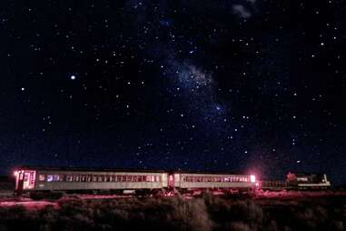 a train in the desert at night