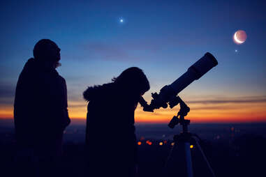 people observing stars, planets, Moon and night sky with astronomical telescope
