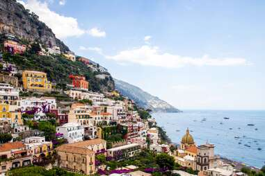 a view of the town and boats in positano, italy