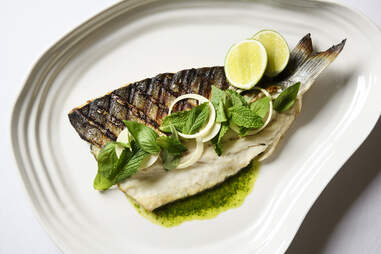 Whole roasted branzino with salsa verde, mint, and basil