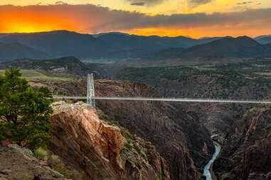 a long skywalk bridge over a valley