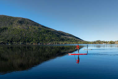 two paddleboarders on a lake