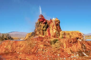 a giant, colorful, active geyser in the desert