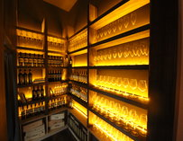 Shelves stacked with wine glasses