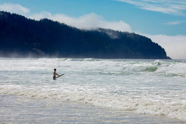 Surfer on the beach of Cape Lookout State Park
