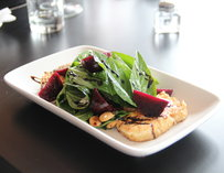 A salad with beets and greens
